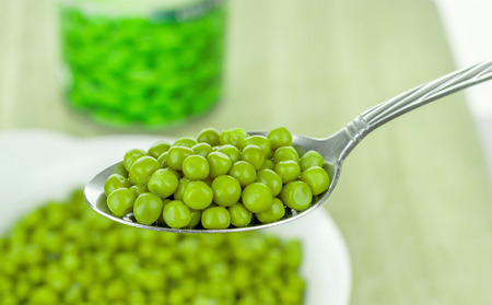 spoonful: A spoonful of tinned canned green peas Stock Photo