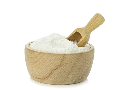 shredded coconut: Desiccated coconut in wooden bowl with scoop on white background