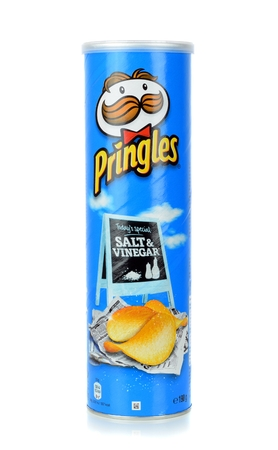 stackable: NIEDERSACHSEN, GERMANY JANUARY 10.01.2015:A tube pack of Pringles Salt and Vinegar crisps chips on a white