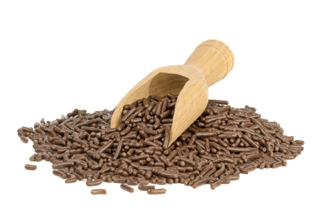 chocolate sprinkles: A heap of chocolate sprinkles with scoop on white background