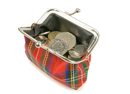 pound coin: An open purse full of British money coins on a white background Stock Photo
