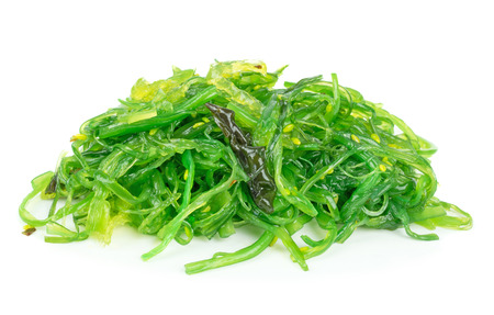 A portion of fresh wakame seaweed on a white background Foto de archivo