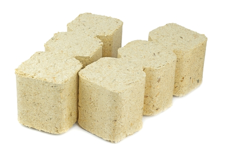 compressed: Compressed sawdust briquettes heating fuel on a white background
