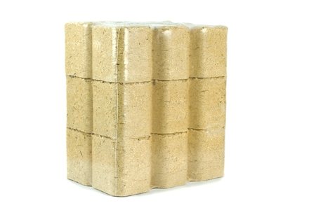shrink wrapped: A multipack of compressed sawdust briquettes heating fuel on a white background Stock Photo