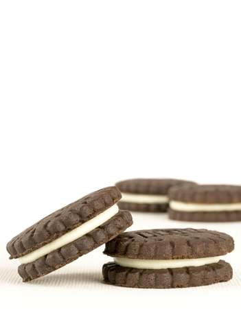 Close up of chocolate biscuits on white background with copy space photo