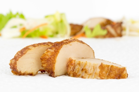 chunk: Fresh grilled chicken slices on a kitchen paper towel