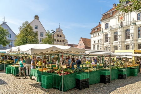 LUENEBURG, GERMANY AUGUST 1, 2018: A fresh fruit and vegetable produce market in the town square of Lueneburg Germany.