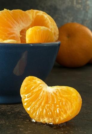 A close up of a juicy segment of an orange tangerine Banco de Imagens