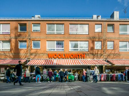 VERDEN, NIEDERSACHSEN, GERMANY MARCH 31, 2019: An image of the Woolworth department store shop front in Verden, North Germany with shoppers and customers.