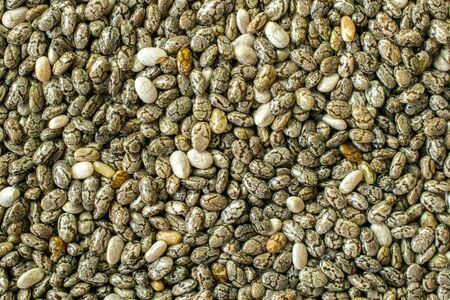 A close up macro wallpaper background image of chia seeds Banco de Imagens