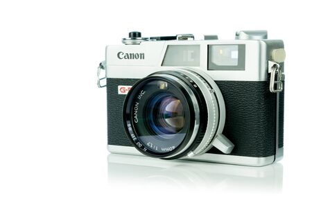 NIEDERSACHSEN, GERMANY APRIL 8, 2019: A Canon Canonet 17 G-III QL retro rangefinder 35mm analog film camera on a white background