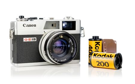 NIEDERSACHSEN, GERMANY APRIL 8, 2019: A Canon Canonet 17 G-III QL retro rangefinder analog camera with Kodak 35mm film on a white background
