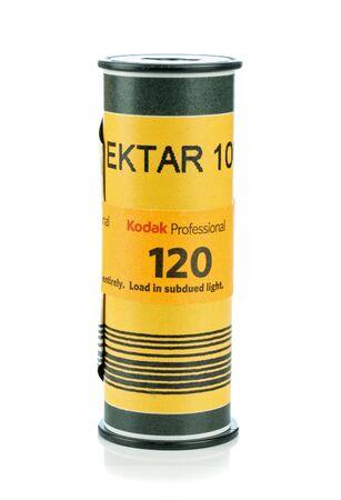 NIEDERSACHSEN, GERMANY APRIL, 9 2019: An unpacked roll of Kodak Ektar 120mm medium format camera film on a white background