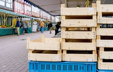 NIEDERSACHSEN, GERMANY OCTOBER 24, 2015: A street scene with empty wooden crates at a fresh fruit and vegetable market. Editorial