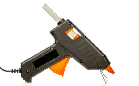 An electric hot glue gun pistol tool loaded with an adhesive stick on a white background