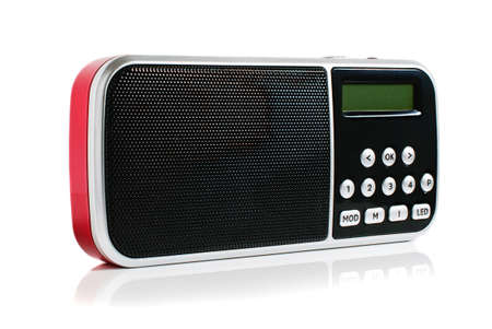 A small red metallic pocket digital radio on a white background Banque d'images