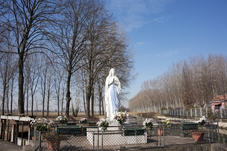 statue of virgin mary on the road photo
