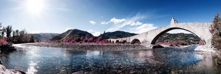 hunchback bridge panorama in bobbio photo