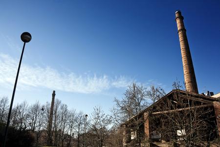 smokestack: abandoned factory with smokestack Stock Photo