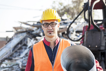 heap of role: man at work in Landfills Stock Photo