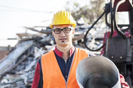 landfills: man at work in Landfills Stock Photo