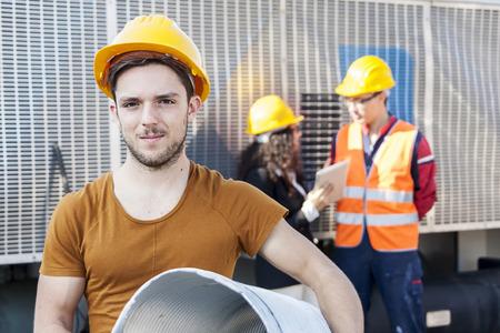 junkyard: young workers in a junkyard