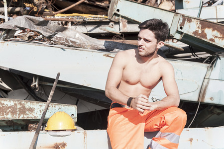 junkyard: young worker in a junkyard