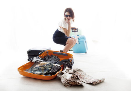 young woman lost the clothes from his suitcase photo