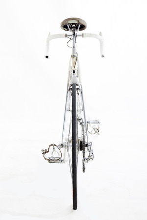 racing bike: vintage racing bike isolated on a white background - back view Stock Photo