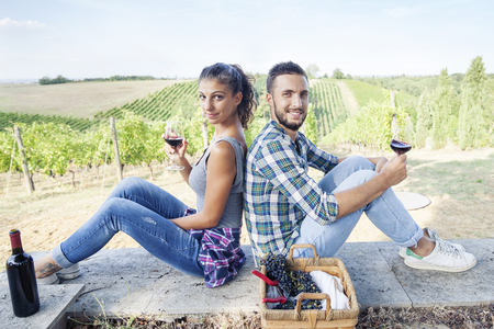 toasting: young couple toasting in a vineyard Stock Photo