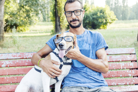 nearsighted: nearsighted man with his dog wearing glasses sitting on a bench