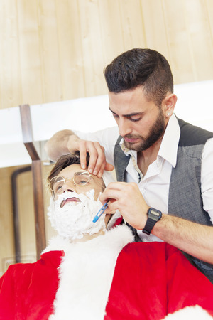 funny bearded man: santa claus cut beard from his personal barber