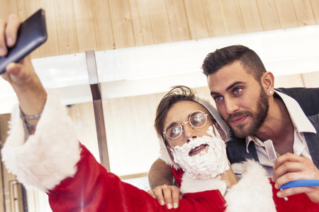 funny bearded man: Santa Claus takes a Selfie with your barber