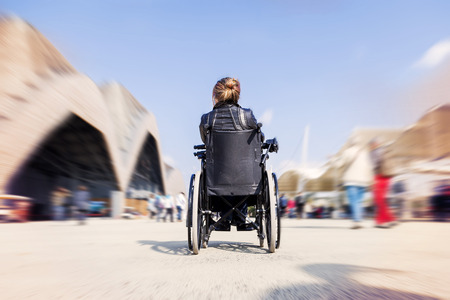 paraplegic: young lady in a wheelchair looking for a destination