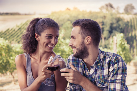 couples outdoors: young couple toasting in a vineyard Stock Photo