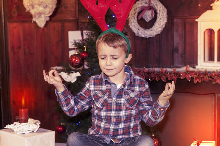 waiting posture: young boy waiting for santa claus sitting on the table