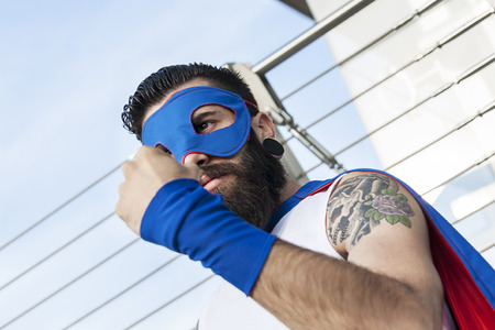 crime fighter: young hipster superhero fights evil