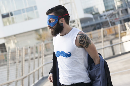 dressing up costume: young hipster superhero fights evil