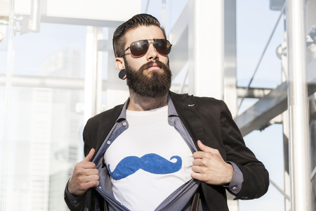 dressing up costume: young hipster superhero oversees capital