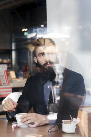 only men: hipster businessman on break for a coffee