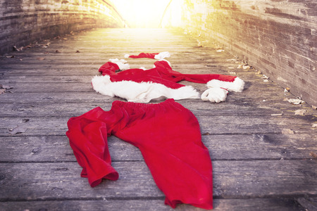 santa suit: santa suit abandoned on a wooden floor warm look colored