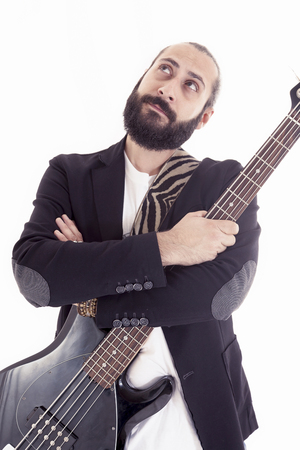 bass player: studio portrait of young bass player on white background