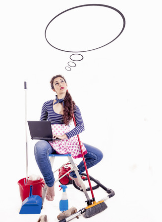 charwoman: young and beautiful housewife thinks of something funny - copyspace in balloon Stock Photo