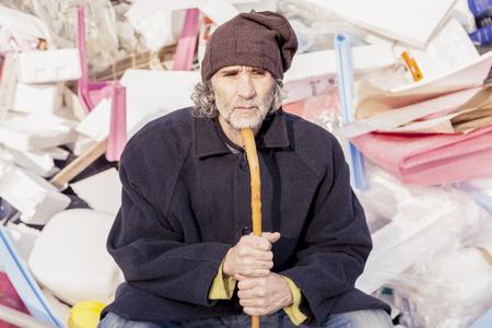 landfills: homeless sitting in landfills in the garbage