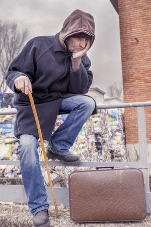 landfills: sad homeless sitting in landfills in the garbage