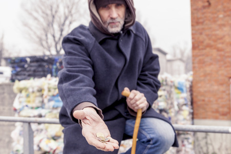landfill: homeless asks charity in landfill