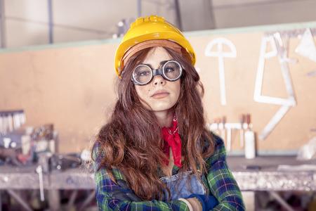taskmaster: portrait of pretty female worker in a steel mill Stock Photo