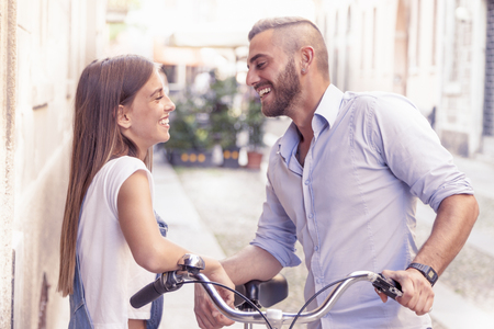 funny bearded man: young couple in love talking in the street Stock Photo