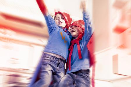 children playing at being wonderful hero