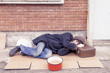 landfill: homeless sleeping on a cardboard in landfill
